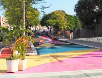 Women walking along colorful street in Fortaleza