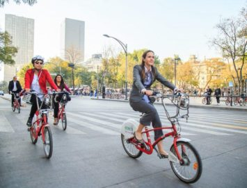 itdp climate week event image - women riding Ecobici bikes in Mexico City